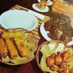 Prawn Spring Rolls, Fried Vermicelli, Tumeric Fried Chicken & Steamed Spicy Fish in banana leave