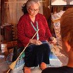 Granddaughter Yazzie, preparing yarn for blanket weaving