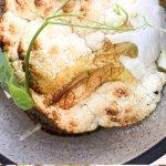 roasted cauliflower, poached egg, black, garlic, chicken skin