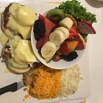 Crab Cakes Benedict with Cheesy Potatoes and fruit
