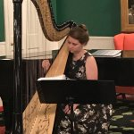 Enjoying the Harpist in the parlor