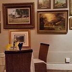 Beautiful original art on the dining room walls.