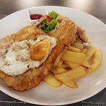 Breaded pork with chips and potato salad