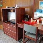 Satellite TV, hot beverage station, and desk