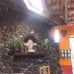 An altar embedded in a cobblestone wall