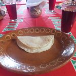 Tortilla with cheese filling with a glass of Roselle Juice