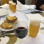 Tasty bread, red wine and beer