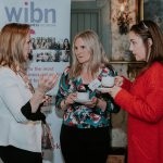 WIBN Members talking business over a coffee