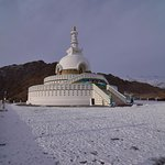 Stupa with the Ladakh Range in the background.