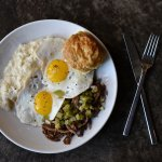 Brisket and Eggs pulled brisket, tomatillo salsa, two cage  free eggs, smoked gouda grits, biscu