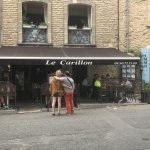 studying the menu at Le Carillon in the charming village of Goult