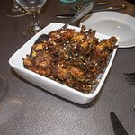 Crispy Brussels sprouts - glazed with harissa and Blackstrap molasses w/toasted seseme seeds