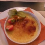 Creme brulee. Topped with fresh strawberry & physallis.