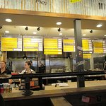 The menu boards, serving, and ordering line.