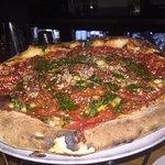 Pizza: clams, marinara, chorizo, pecorino romano, garic, chili flake, sofritto