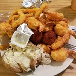 Big shrimp with yummy batter, hush puppies, onion rings and baked potato.