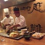 The teppanyaki chef putting on a show