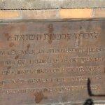 "A memorial plaque written ""In memory of he holocust victims"""