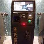 Check-in kiosk which issues key cards