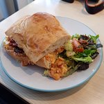 Egg mayo and chorizo sandwich with salad.