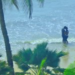 A couple in love by the beach, seen from my room