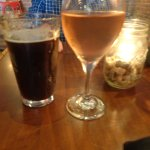 Our drinks, a dark ale, and a rose wine