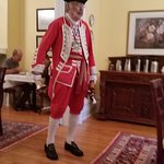 Town Crier in uniform visited during breakfast