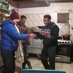 Lynne with Adil & Hergezi in the (clean!) kitchen. These guys are great cooks.