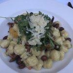 Gnocchi with chanterelle sauce, arugula, hazelnuts and parmesan