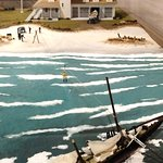 A model showing a rescue of people on a ship wrecked on a sand bar with a nice model of this mus