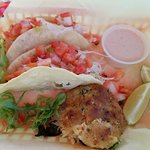 Two fish tacos and a crab cake. Yum!!