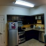 Pano of kitchen and entry door. Small door is a small closet