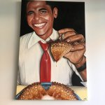 Portrait of President Obama enjoying a crêpe-style pancake