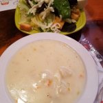 Cream of potato soup and a salad with ranch dressing.