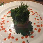 Fabulous crab, avocado and red pepper starter topped with sweet pea-shoots