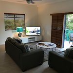 Living room with open balcony and large HD TV