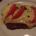 Schnitzel smothered with Dutch cheese and tomatoes -- WOW!