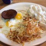 Eggs sausage hash browns and biscuit and gravy