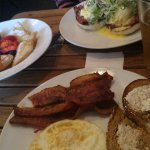 Breakfast staples, beignets with berries, and eggs and ham Benedict. Add 1 beer and 2 cortados =