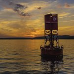 Buoy at sunset by newbie photographer