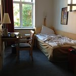 Bedroom in unrenovated room 119