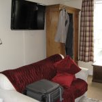 Large settee, with TV behind