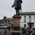 A statue of Henry Richard in square bu Talbot Hotel