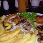 probably not the best photographher rib eye with stilton sauce plus chips peas mushroom and toma