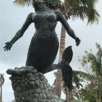 Sirena del Mar statue by the main entrance. Private beach. Ocean views.