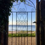 Gate to beach promenade from Invernairne garden
