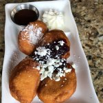 Beignet appetizer with goat cheese and mascarpone. The syrup has a kick with sriracha!