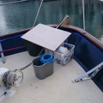 A mop bucket and other detritus on the bow.