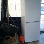 A fridge and other junk on the deck.