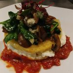 Grilled polenta cake, house made riccota, tomato compote, foraged mushroom, spinach, and blue ch